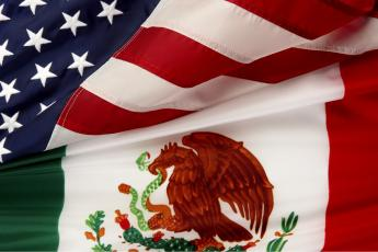 The Mexican and American flags